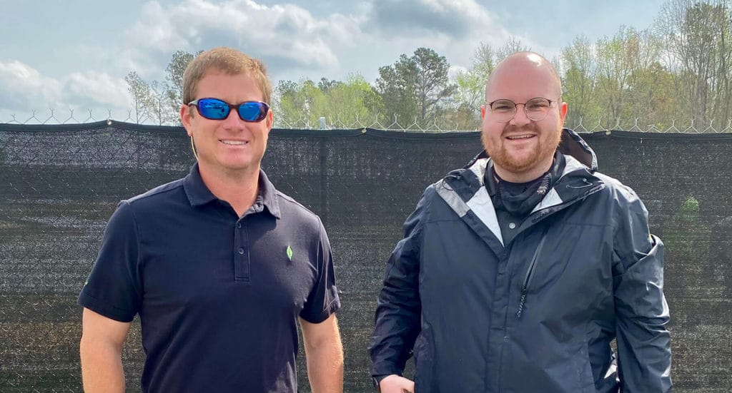 Spring Shine On Champion, Mark Watson, from New Leaf Builders standing next to Building Performance Technician, Richard Bohlen, from Southern Energy Management