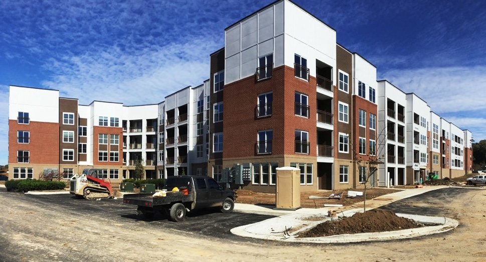 Multifamily apartment building with blue sky in the background