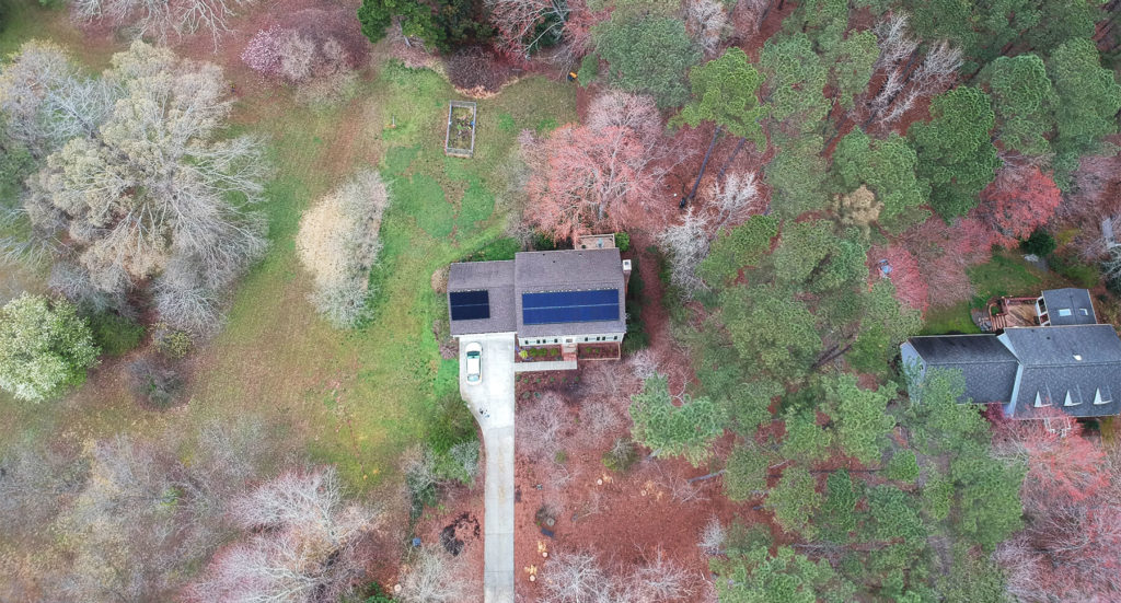 Aerial view of a home with a roof mounted solar system