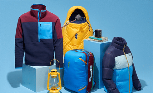 Fleece sweater, yellow jacket, and other assorted outdoor gear items from Cotopaxi