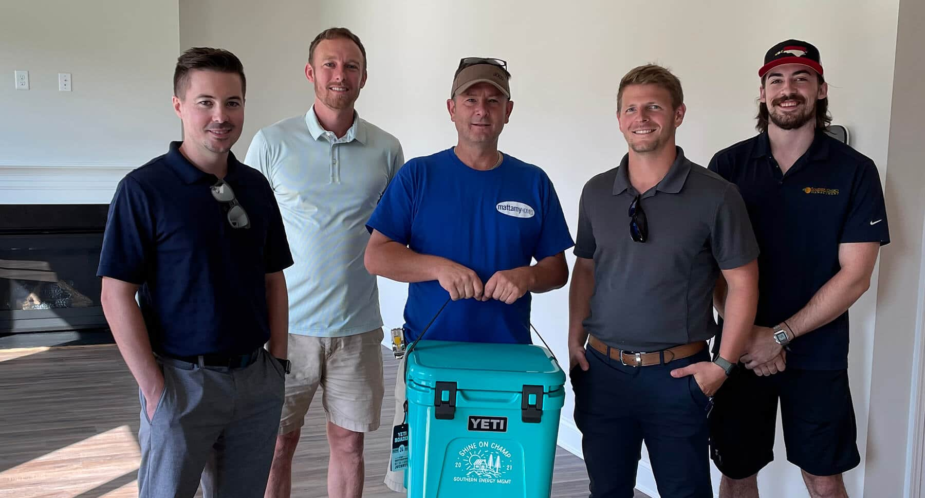 Rick and team from Mattamy Homes with Taylor and Noah from Southern Energy Management during the presentation of the Shine Champ award