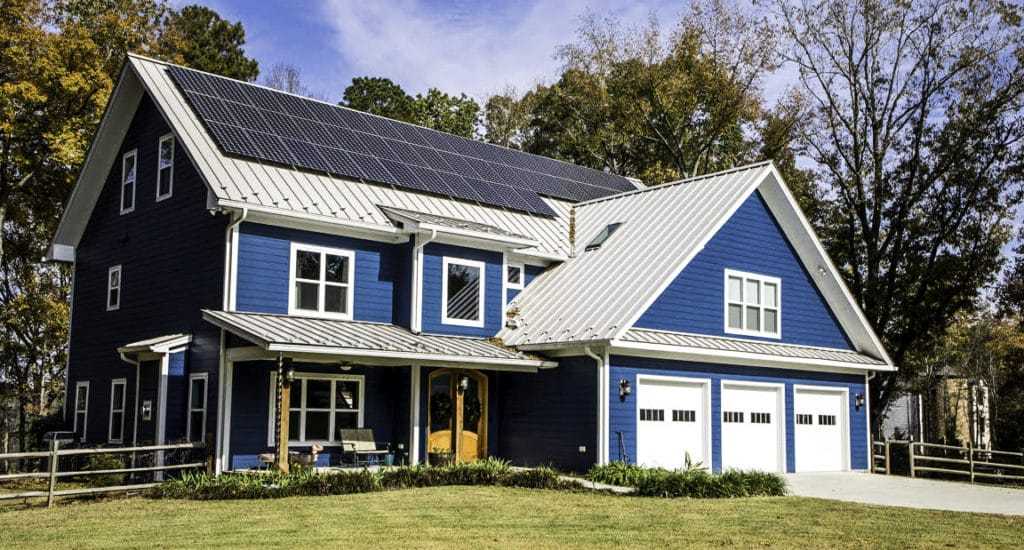 Side view of New Home With Solar Panel System