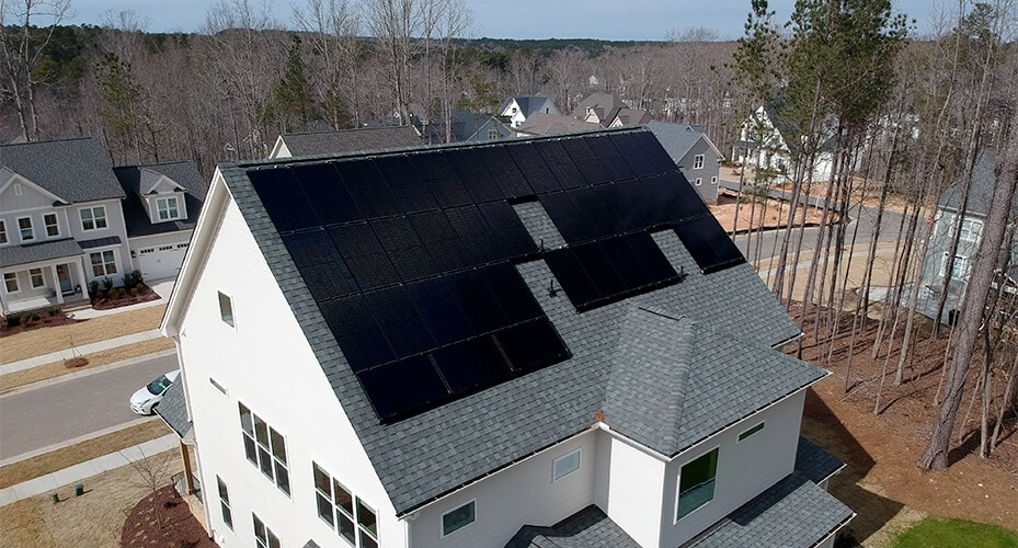 Aerial view of a home solar system mounted on the roof