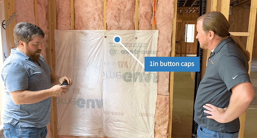 Button caps with a 1inch diameter installed to hold the flexible air barrier into place