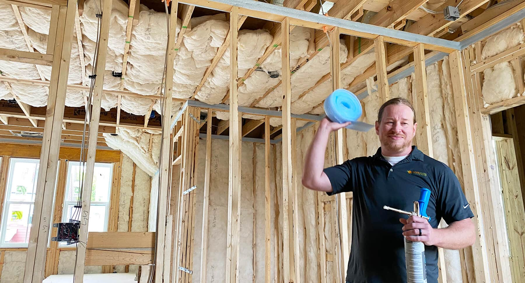 Matt, building performance expert, from Southern Energy Management holding sill seal and foam gasketing material on site for wall top air sealing