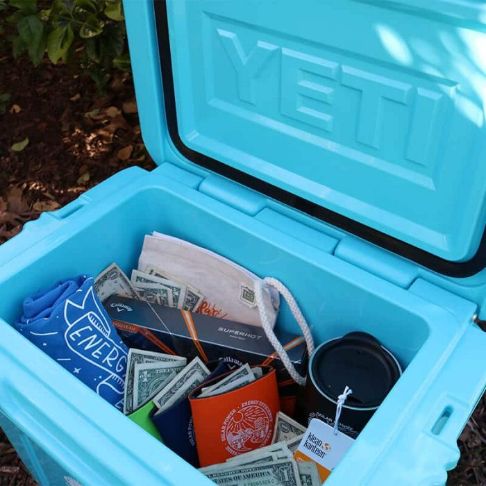 The inside of SEM's Yeti Cash Cooler Award, filled with cash and swag
