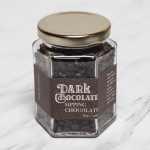 Jar of vegan chocolate chips used to make sipping chocolate from French Broad Chocolate