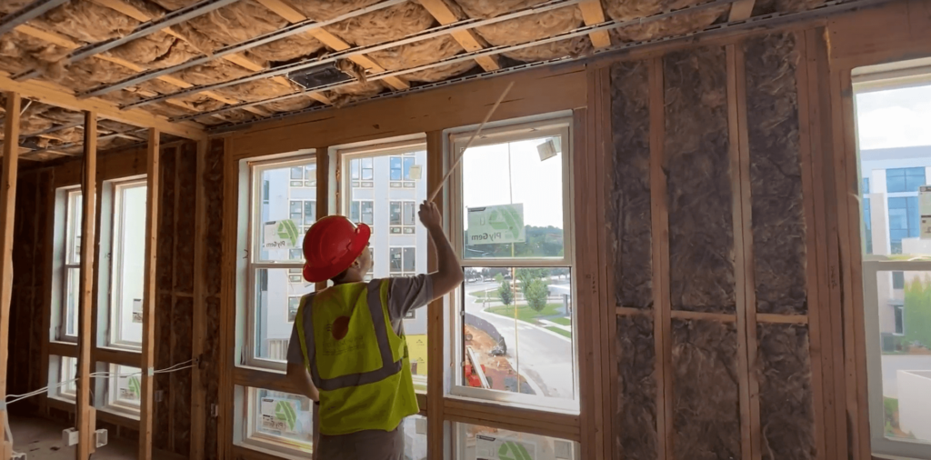 Multifamily services team inspects building performance on site during construction