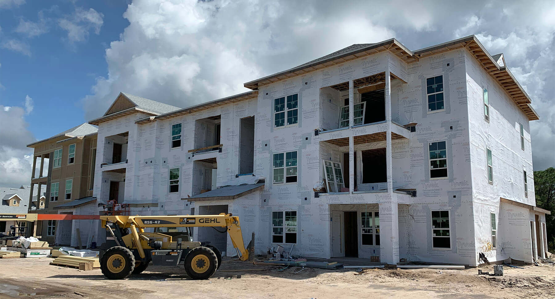 New construction multifamily housing with construction equipment