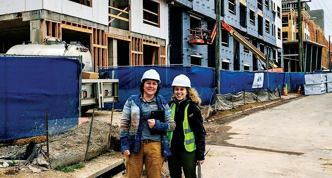 Laurie Colwander onsite during multifamily construction